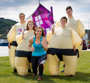 No Repro Fee: Sinead Desmond launches Ireland's 1st Sumo Run! The 2015 Sumo Run is a fun charity event in inflatable sumo suits with a 5km route on the seafront in Bray, Co.Wicklow, in aid of Purple House Cancer Support. The event takes place on Sunday 23rd August at 12 noon. It is also a Guinness World Record attempt for the largest gathering of people dressed as Sumo wrestlers in the same area. Visit sumorun.ie for entry details. Pictured: Rachel Murray, Scarlett Glynn (11), Sinead Desmond, Max Duggan (11), Evan Masterson. PIC: Joe Keogh